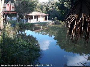Linda propriedade com 4800m², lago, casa nova, pomar