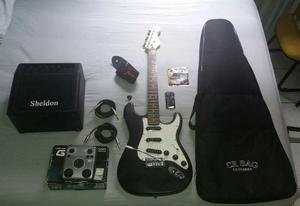 Guitarra + amplificador + pedaleira