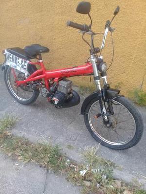 Bicicleta motorizada original de fábrica em bom estado de