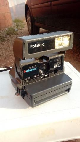 Máquina fotográfica antiga polaroid 1980