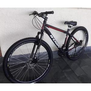 Vendo: bicicleta wendy, cor preta, aro 29, freio a disco.