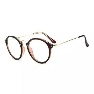 Armação redonda de metal e acetato para óculos de grau
