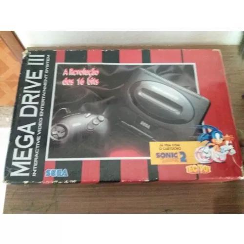 Mega drive na caixa com 6 cartuchos e controle 6b