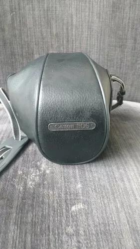 Camera fotografica canon eos 3000 com bolsa manual e nota