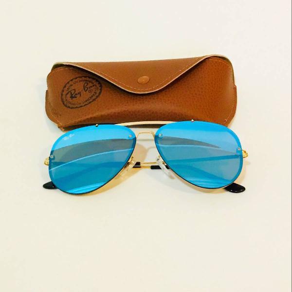 Culos de sol feminino espelhado azul e dourado