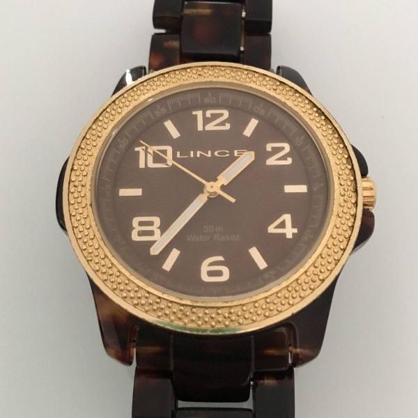 Relógio dourado, casco de tartaruga