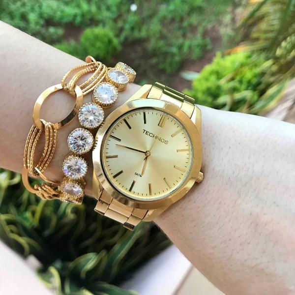 Relógio dourado technos