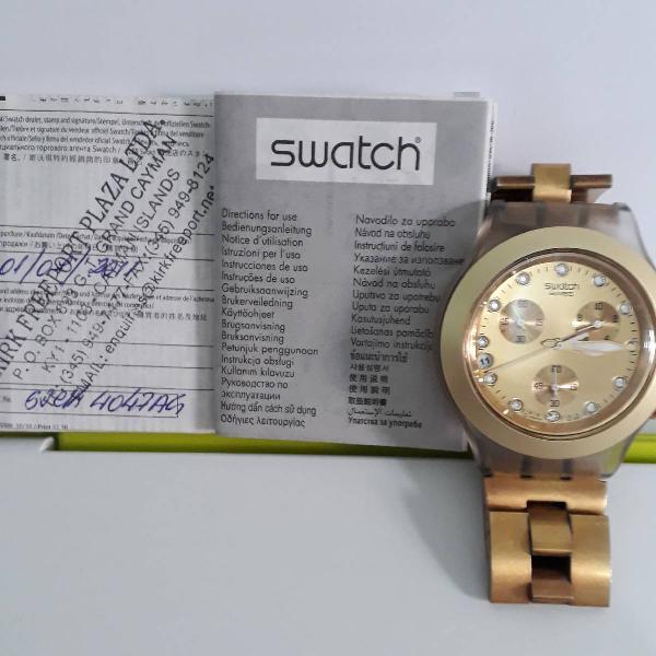 Relógio swatch dourado original.