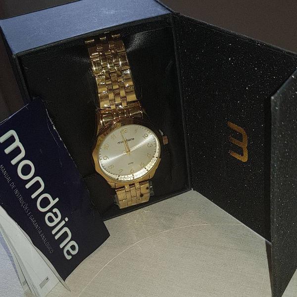 Relogio mondaine dourado novo na caixa e com certificado.