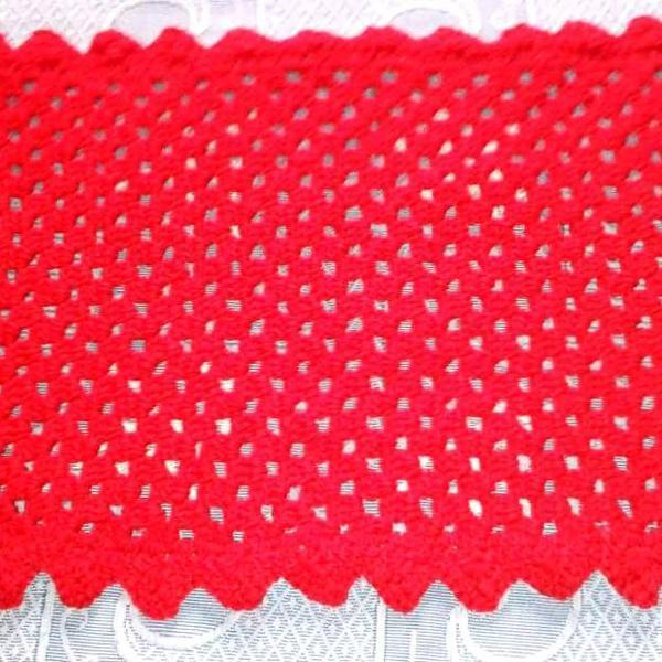 Tapete vermelho com detalhe de flor