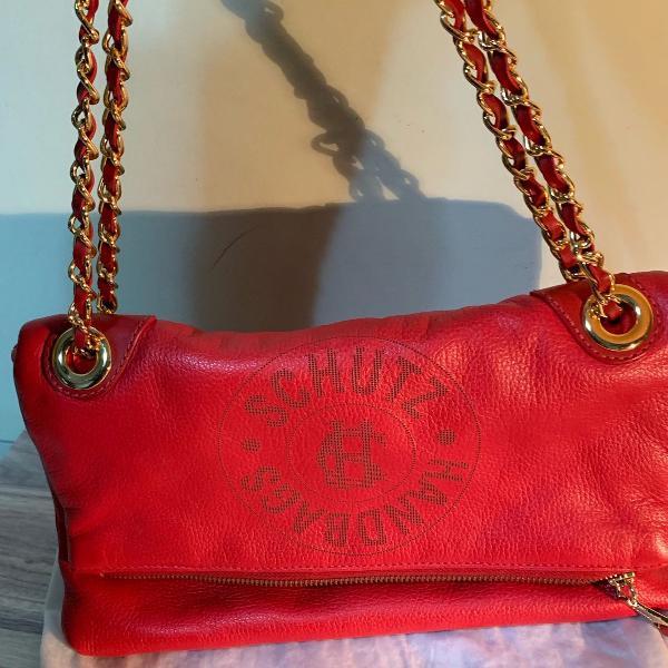 Bolsa vermelha com logomarca