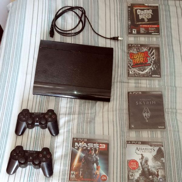 Console ps3 original+ 6 jogos (assassin's creed, guitar