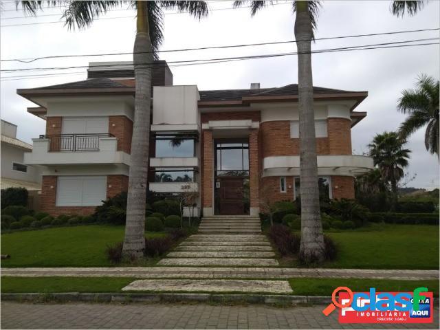 Casa 06 dormitórios (05 suítes), venda direta caixa, bairro jurerê internacional, florianópolis, sc, assessoria gratuita na pinho