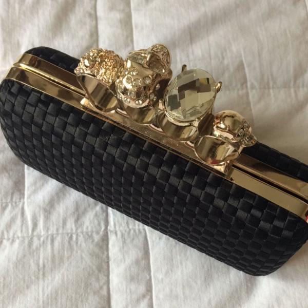 Bolsa clutch com anéis