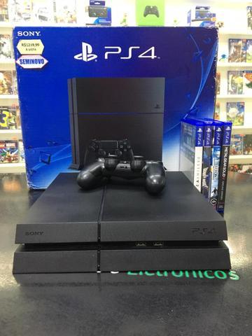 Playstation 4 fat com um jogo brinde um controle e garantia