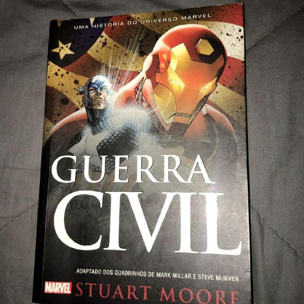 Livro marvel guerra civil com marcador de página