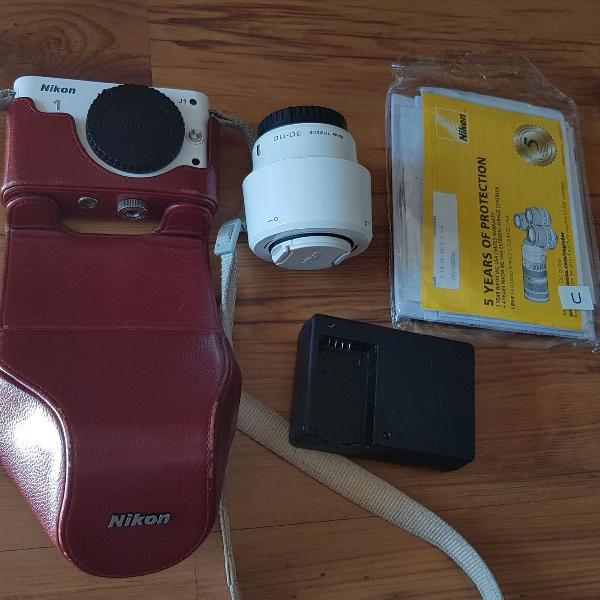 Máquina fotográfica nikon j1 seminova