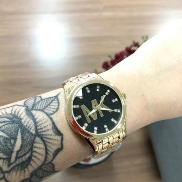 Relógio mk dourado e preto