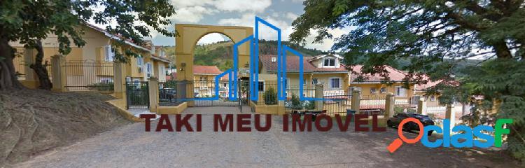 Linda casa em condomínio fechado 3 dormitórios j. carvalho 355.000 financia
