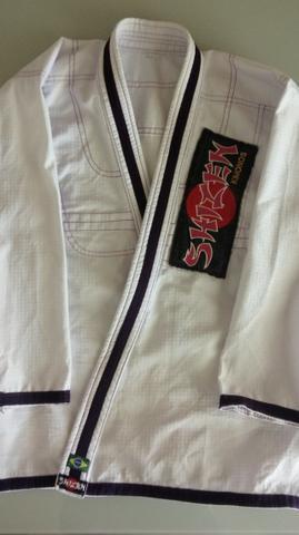 Kimono jui jidsu feminino a1 branco com detalhes roxos