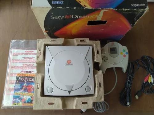 Dreamcast com caixa berço + manual e folhetos 02 jogos cdr