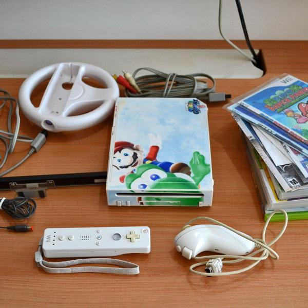 Nintendo wii desbloqueado completo + volante + 12 jogos