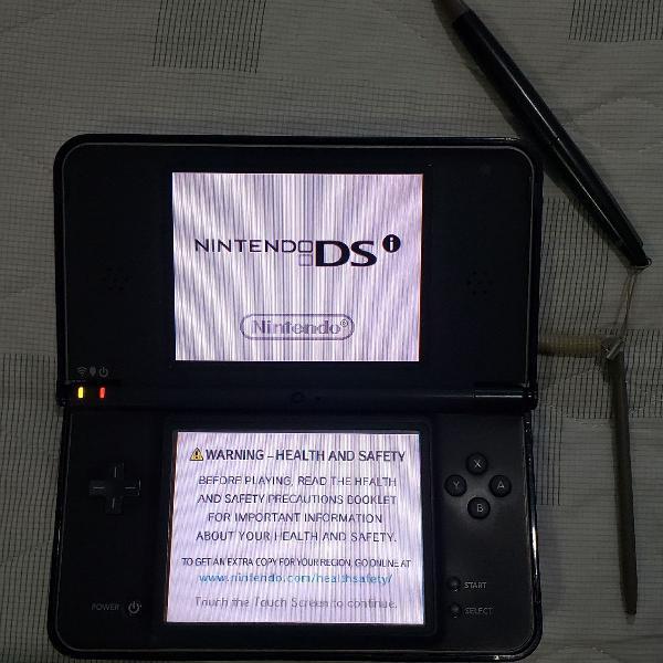 Nintendo dsi xl completo na caixa + case metálica