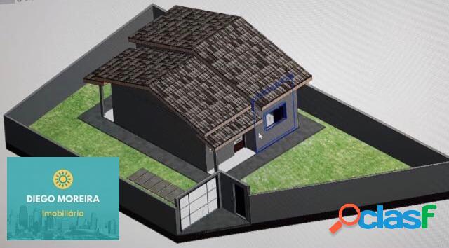 Casa nova á venda em terra preta com 2 dormitórios