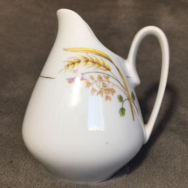 Leiteira porcelana real