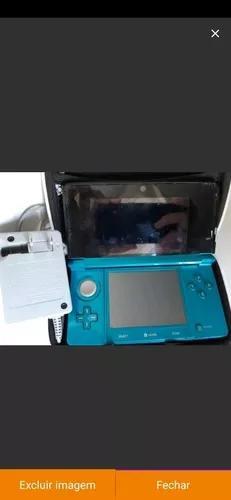 Nintendo 3ds azul aqua acompanhando 2 jogos originais