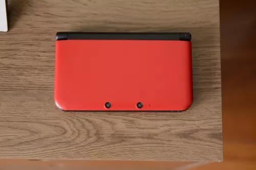 Nintendo 3ds xl vermelho com carregador, manuais e ar cards