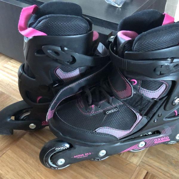 Patins oxelo preto e pink feminino tamanho 35