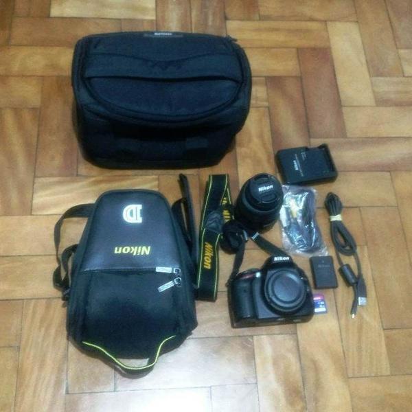 Nikon d5100 + 18-55mm + 2 bolsas completa