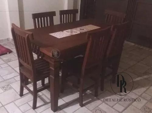 Mesa de jantar com 6 cadeiras cor escura com ladrilhos