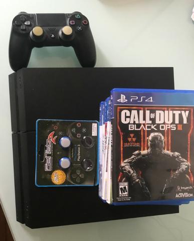Playstation 4 com 6 jogos/ pouco usado