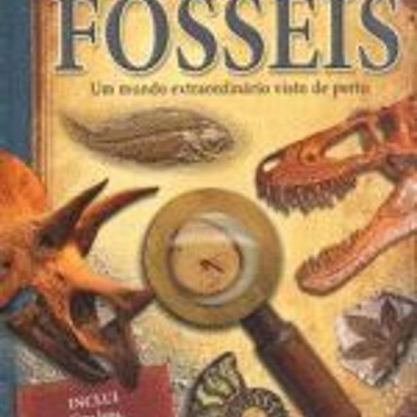 Livro de ciências fósseis de dinossauros com lupa