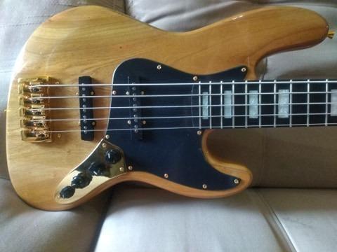 Vendo lindo jazz bass, novo impecável todo top