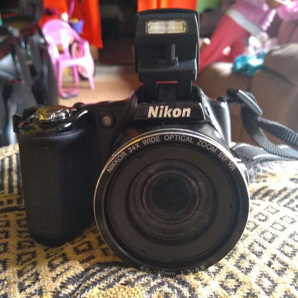 Tima máquina fotográfica