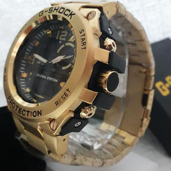 Relógio g-shock masculino dourado fundo preto analógico