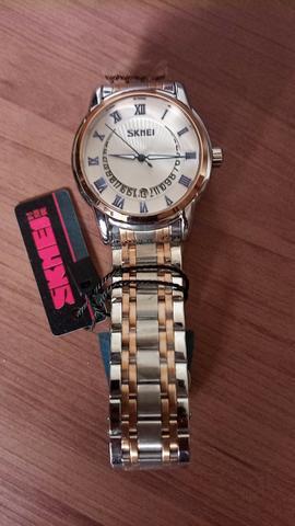Relógio unissex skmei analógico prata e dourado original