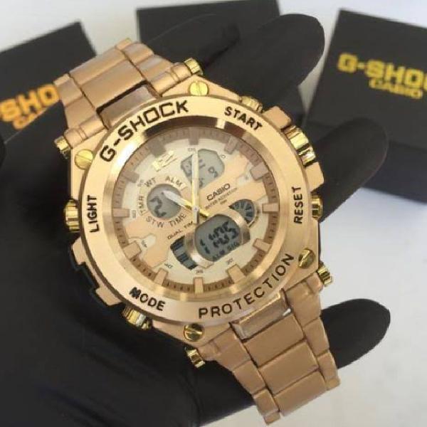 Relógio g-shock dourado analógico digital fundo dourado