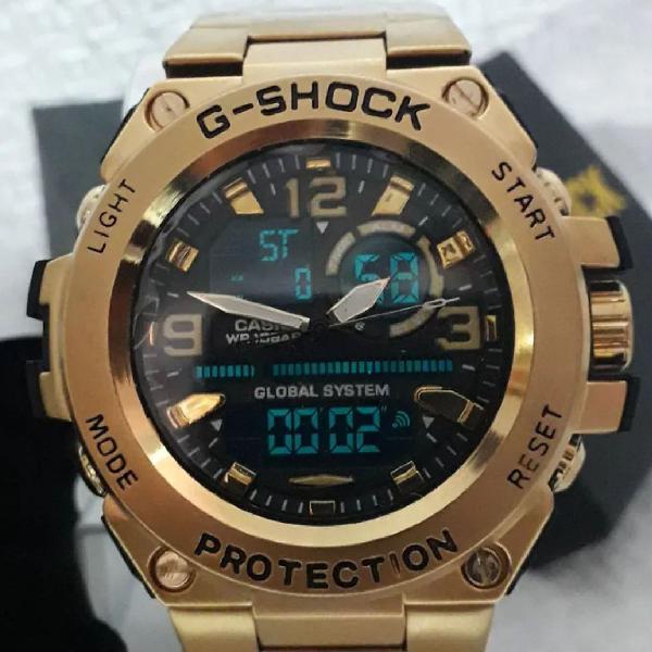 Relógio g-shock dourado analógico digital fundo preto
