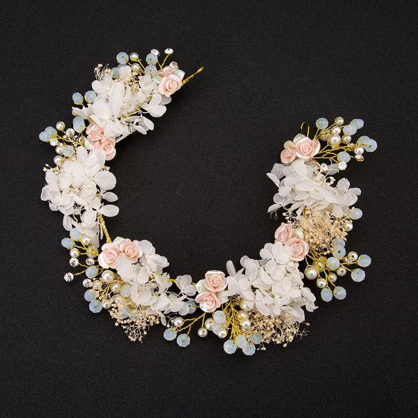 Arranjo tiara de cabelo noiva em flores que são sintéticas