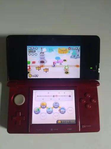 Nintendo 3ds vermelho, super mario bros 2 e 3d land