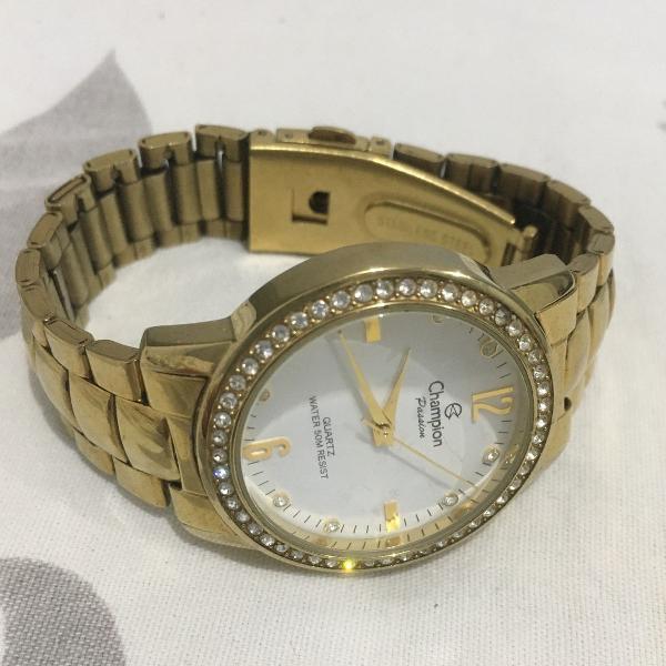 Relógio champion dourado original