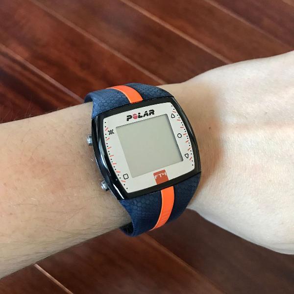 Relógio e monitor cardíaco polar ft4, faixa laranja