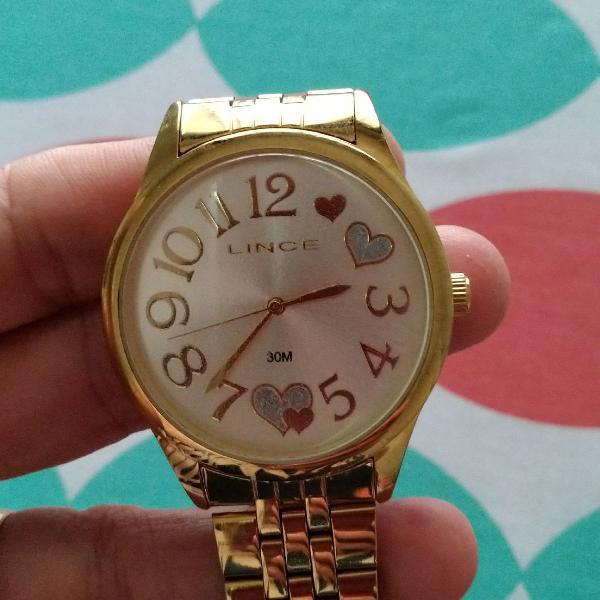 Relógio lince dourado.