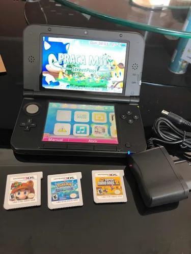 Nintendo 3ds xl azul com 3 jogos originais.