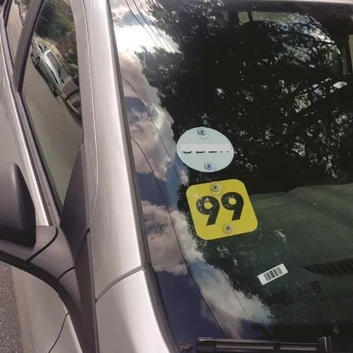 2 placas adesivadas ub.. e 99 taxi com ventosa