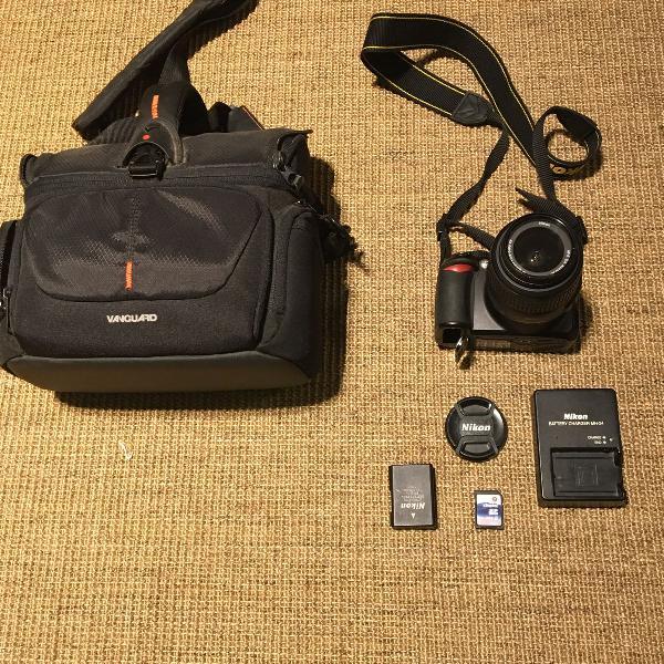 Câmera nikon d3100 semi nova. 7570 clicks- kit completo